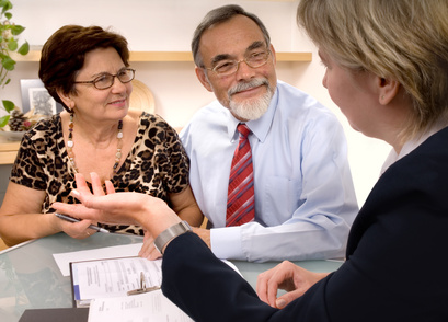 Mature couple talking to financial planner
